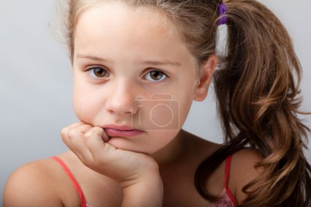 Photo for Sad girl on grey background - Royalty Free Image