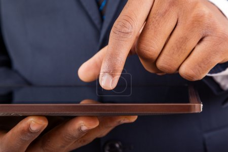 African American businessman working on a digital tablet