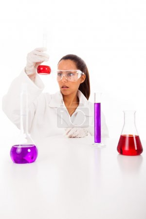 Female researcher checking test tubes, isolated on white