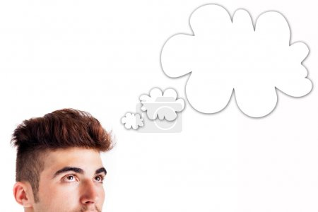Photo for Cropped image of young man thinking, cloud for your text - Royalty Free Image