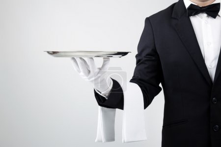 Photo for Waiter holding empty silver tray over gray background - Royalty Free Image