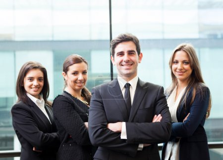 Photo for Businessman leader on the foreground of his team - Royalty Free Image