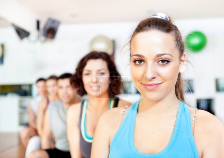 Group of smiling at the gym