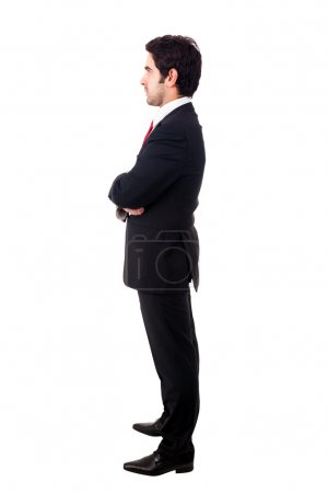Side view profile of a young business man. Full length, isolated
