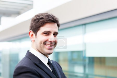 Smiling young business man portrait