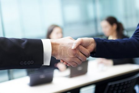 Business handshake and business people at the office
