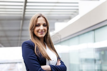 Photo for Portrait of a happy smiling young business woman with cross-armed - Royalty Free Image