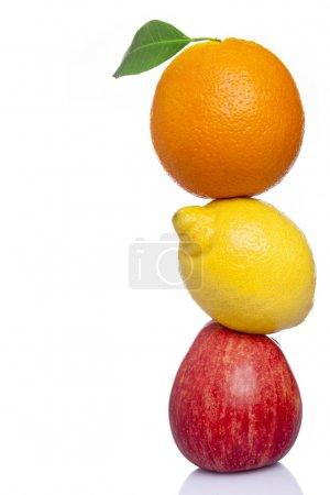 Stack of fresh fruit, isolated on white background