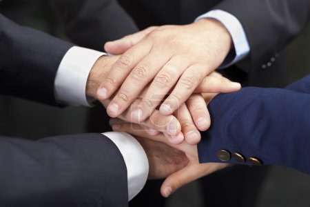 Businesspeople hands on top of each other