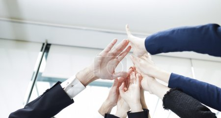 Closeup of hands of business people giving high-five