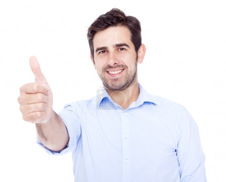 Photo for Handsome latin man thumbs up over a white background - Royalty Free Image