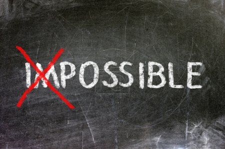 Photo for Impossible and possible option handwritten with white chalk on a blackboard. - Royalty Free Image