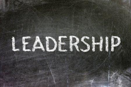 Leadership handwritten with white chalk on a blackboard.