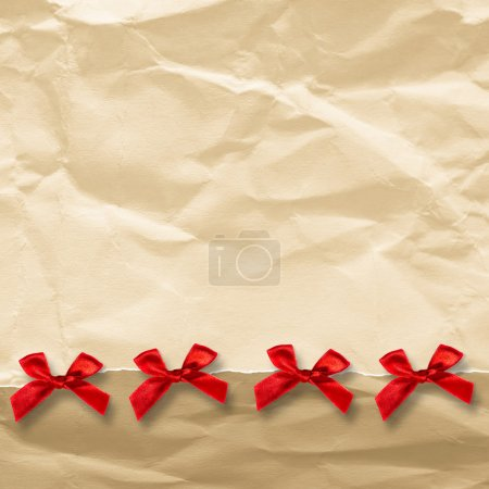 Paper with a red ribbon