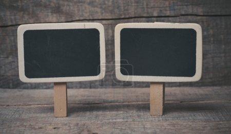 Small wooden framed blackboard on wooden background