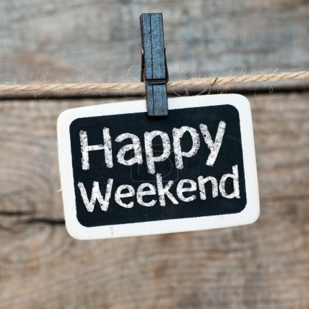 Photo for Happy Weekend on old photo and clothes peg on a wooden background - Royalty Free Image