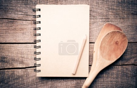 Photo for Old recipe notebook, spoons on wood background with pencil - Royalty Free Image