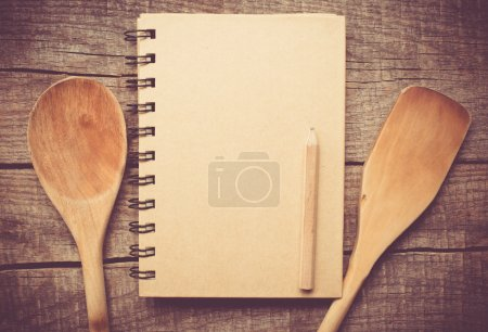 Old paper and wooden spoon