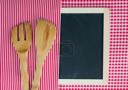 Menu blackboard with wooden spoon and fork