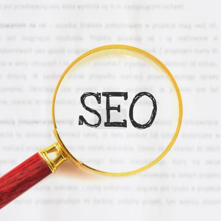 Magnifying glass, with SEO sign