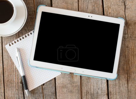 Photo for Empty tablet pc and a coffee and notebook with pen on wood table - Royalty Free Image
