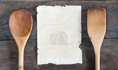 Photo for Old recipe notebook, spoons on wood background - Royalty Free Image
