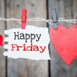 Happy Friday on instant paper and small red hearts...