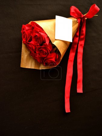 Bouquet of red roses with message card