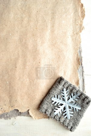 Silver snow flake on knit with papers