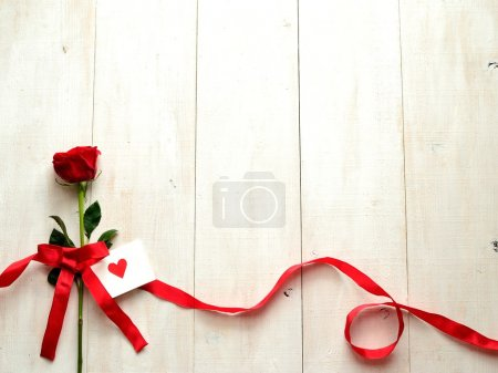 Red rose with message card