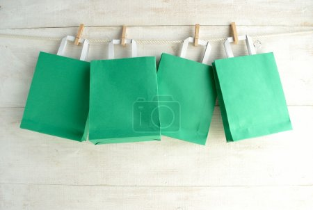 Green paper bags with clothes pins