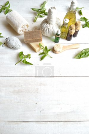 Aromatherapy supplies with basil leaves