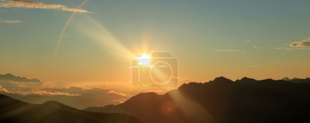 Photo for Sunrise over the Alps Mountain Range - Royalty Free Image
