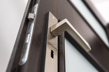 Modern, contemporary satin handle and keyhole deta...