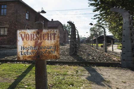 Careful, High-Voltage, Danger sign in Auschwitz II-Birkenau camp in Brzezinka