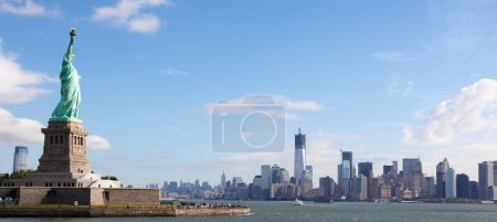 Photo for Panoramic skyline of Manhattan with the Statue of Liberty in New York City, US - Royalty Free Image