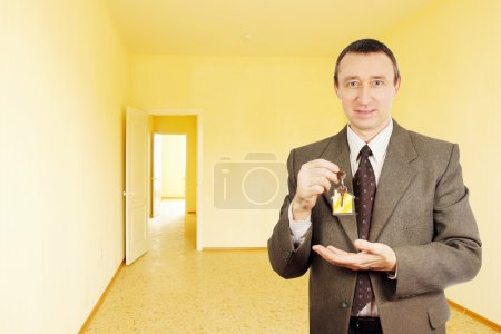 Happy man got a key of new apartment