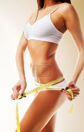 Photo for Beautiful woman body in white with yellow measure - Royalty Free Image