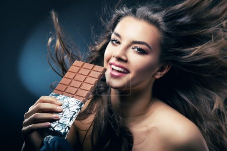 sexy smiling woman with chocolate and desire