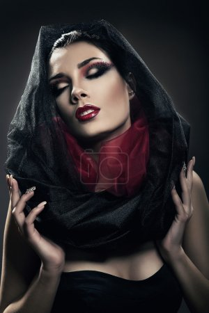 mysterious woman with closed eyes in black hood