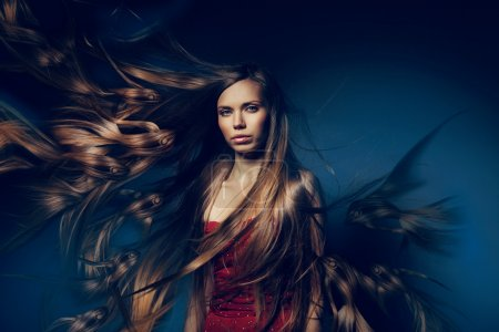 Photo for Pretty woman with long fish hair - Royalty Free Image