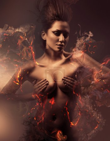 Photo for Burning erotic sexy beautiful woman in dirty mist - Royalty Free Image