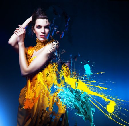 Photo for Sensual sexy woman in long yellow dress and splatter - Royalty Free Image