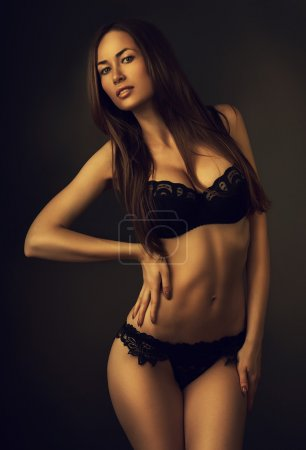 Photo for Hot attractive girl in dark - Royalty Free Image