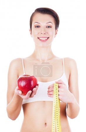 pretty girl in white with measure and red apple
