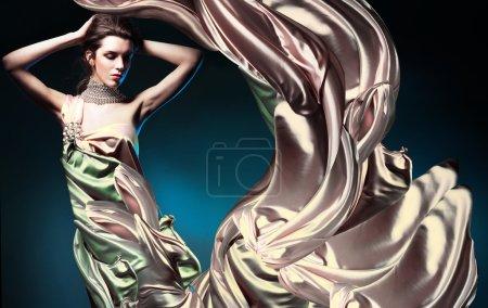 Beautiful woman in long fairy dress