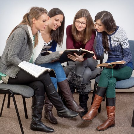 Photo for Young woman teacher teach God's Words to a women team - Royalty Free Image