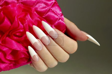 Long French nails.