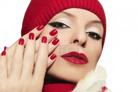 Red lips and fingernails.