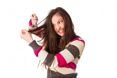 Woman hold damaged hair and cut them with scissors